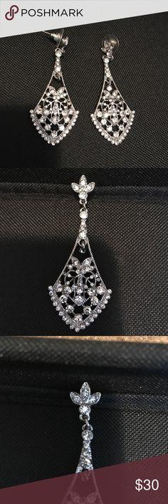 Davids bridal earrings, never worn Davids Bridal earrings, never worn, bought for my wedding and wore borrowed earrings instead Davids Bridal Jewelry Earrings