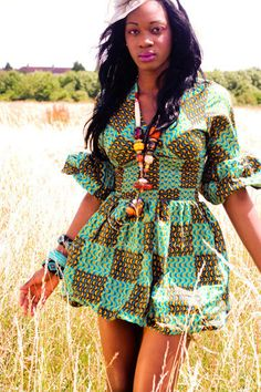 This short puffy shirt style African dress is just adorable and flattering for a womans figure!