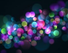 Blurry lights background with colorful sparkling lights. Stock Photo