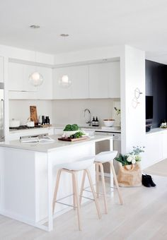 beautiful small kitchen, love the white, dark section, breakfast bar, island area
