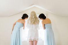 #Gorgeous #Bride and #bridesmaids looking out window at groom. #beautiful #blonde  #wedding #love #bridal #curlyhair #hair #weddinghair #veil #blue #dresses