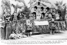 "The Mission Play float at the Tournament of Roses Parade won the first prize silver cup on January 1, 1922. It was a combined entry by the Mission Play production and the City of San Gabriel, where the play was being performed. The float featured a replica of the Mission San Gabriel campanile at its center and was attended by men and women in costumes evoking the Spanish mission era and ""the splendor of Old Spain."" John Steven McGroarty Collection. San Fernando Valley History Digital Library."