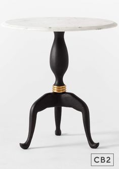 Brett Beldock modernizes the traditional dining table with high-end materials and unexpected texture. Honed Volakas marble with mitered edges tops a textured cast aluminum base with a dark bronze finish. Base is hand-polished to reveal some flecks of bright brass and finished with an antique brass ring. Table comfortably seats two.