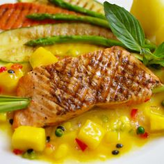 This quick and healthy salmon recipe is a great go-to on busy nights when you still want a fresh, filling meal — and it's ready in 30 minutes!Recipe: Salmon with Mango Salsa Healthy Salmon Recipes, Healthy Dishes, Fish Recipes, Seafood Recipes, Healthy Eating, Fast Dinners, Easy Meals, Mango Salsa Recipes, Recipes