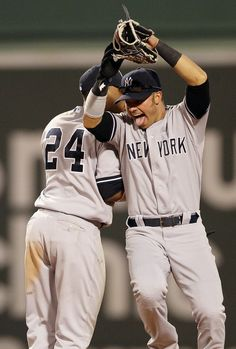 April 21, 2012: #24 Robinson Cano and #33 Nick Swisher celebrate the New York Yankees 15-9 win over the Boston Red Sox at Fenway Park in Boston, Massachusetts.