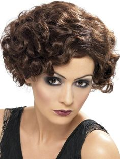 The adult 20s Flapper Finger Wave Wig features brunette brown synthetic hair in an ultra-short, bob cut with finger wave curls and side part. Inner mesh netting with elastic lining provides a comfortable fit. It is a high fashion hairstyle alternative to the basic bob that rocked the roaring twenties era. Our 20s Flapper Brown Finger Wave Wig is ideal for your Charleston, Gatsby girl or flapper costume. One size fits most adults.