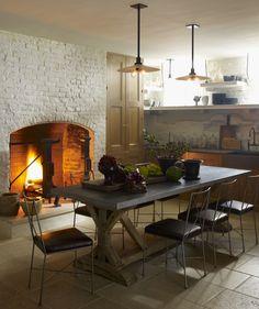 Steven Gambrel - Interior Designer - New York - Contemporary - Transitional - Dining Room - Kitchen - Exposed Brick - Cozy - Neutrals - Fireplace - Vases - Wood Furniture - Tiled Floor - Ceiling Lights - Dangling Lights - Plants - Sink - Shelves - Decor  - Display