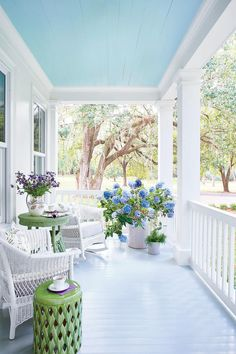 """I love the """"Haint Blue"""" painted porch cieling. A Charming Southern Cottage – Blue and White Home Farmhouse Front Porches, Cottage, White Cottage, Home, Southern Cottage, Front Porch Decorating, Decks And Porches, Porch Design, Blue Ceilings"""
