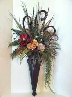 This pair features burgundy red magnolia, cream hydrangea, red hydrangea, tall chocolate brown dried banana sticks, an abundance of pheasant feathers and lot's of greenery. Designed by Amy Johnson - Greatwood Floral Designs. Vintage Wall Sconces, Rustic Wall Sconces, Candle Wall Sconces, Arte Floral, Floral Wall, Traditional Wall Sconces, Silk Floral Arrangements, Succulent Arrangements, Sconces Living Room