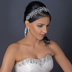 Simply breathtaking! This gorgeous bridal hair vine is decorated with sparkling rhinestones, Swarovski crystals and luxurious freshwater pearl in a rhodium setting. A single hoop is stationed at the e