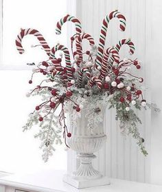Check out this collection of 36 Impressive Christmas Table Centerpieces and find how to decorate your holiday table. Tie red-and-white peppermint sticks around a vase with a.use candy canes in centerpiece. great idea for the kids table at Christmas d Noel Christmas, Winter Christmas, All Things Christmas, Christmas Wreaths, Whimsical Christmas, Beautiful Christmas, Outdoor Christmas, Christmas Morning, Christmas Window Display Home