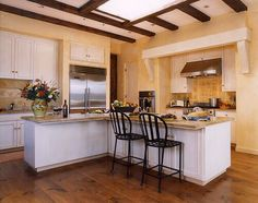 like the overall feel of this color combo b/w cabinets, walls, dark accents . . .