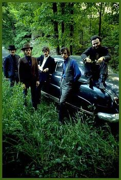 The Band, outside Rick Danko's Zena home, posing with his Hudson, Woodstock, NY, 1969. The Place to be! Artists, musicians, actors, actresses and the rich and famous love the Catskill's! Why aren't you here? Get your own! Call Upstate NY & Catskill's Real Estate & Land Expert. Kellie Place at Century 21 ~ 607-434-5263 www.century21upstatenewyork.com