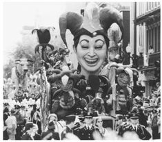 A Vintage shot of Mardi Gras Rollin' through New Awlins! Gone are the days of Da' Zulu Krewe throwing their painted coconuts....but thank the  good Lord Mardi Gras will never die and the Big Easy will never sleep.