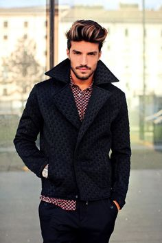 Armani. Not a fan of the hair, but love the houndstooth here