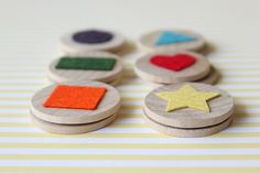 How to make your own 'shape memory game' out of wooden discs and felt cut outs. I'm not crafty, but I think I can do this!