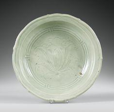 Lot 112 | Sotheby's  Plat en porcelaine céladon Dynastie Ming, XVE siècle A CELADON-GLAZED DISH, MING DYNASTY, 15TH CENTURY. Diameter: 37 cm.