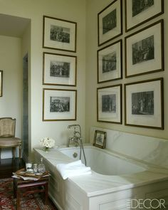 Julia-Reed-house-ELLE-DECOR-elegant bathroom with art. I wish this type of tub ruled. I'm so sick of the free-standing boats posing as bathtubs.