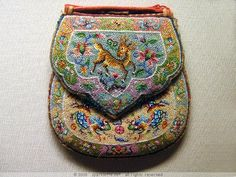 This colourful beadwork wedding purse features deer and dragon motifs. Not only are the glass beads minuscule (typically imported from Europe), Nonyas (Chinese Peranakan women) are well-known for their skillfulness in embroidery and beadwork. thousands of them have been painstakingly threaded together to create the densely beaded design.