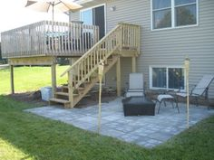 deck and patio. Definitely want to redo our deck so the stairs come out like this!