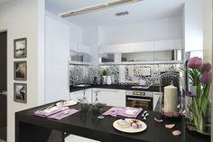 Разделителем между кухней и гостиной становится высокий обеденный стол…