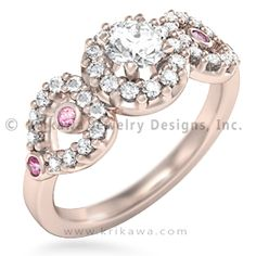 Heart Halo Three Stone Engagement Ring - What is more feminine and elegant than diamond-paved hearts? On each side of the center stone is a heart for you and another for the love of your life.