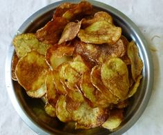 I like home-made potato chips. They are fresh, crispy and are tasteful evening snack with coffee. It takes just 25 to 30 minutes to make the fresh potato chips. Please see my recipe below.