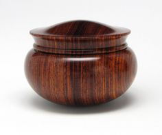 Tropical exotic turned wood box by Mike Stafford. Turned-wood boxes require incredible skill to craft - especially ones such as this with a rounded bottom, since both the box and the lid must be perfectly balanced to sit upright. Beautiful work.