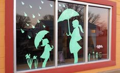Spring window display: April showers bring May flowers.  Can easily morph into Mother's Day display with a few add-ons.