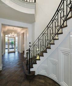 Beautiful French Provincial staircase, Parquetry flooring, wrought iron balusters.