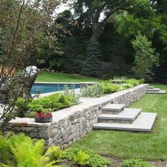 Retaining Wall Design for Safety and Beautify Exterior: Hardscape Retaining Wall Design With Outdoor Chaise Lounge Chairs And Wicker Chair Also Stairs From The Pool Decking Plus Planting Beds Above Ground Pool Steps, Above Ground Pool Landscaping, Backyard Pool Landscaping, Backyard Pool Designs, Above Ground Swimming Pools, Swimming Pool Designs, In Ground Pools, Front Yard Landscaping, Landscaping Ideas