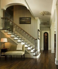 A tasteful way to do wallpaper - simple yet refined. I also love the lights going down the hallway - a little surprise element.