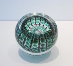 "Tom Philabaum ""Reptile Geode Paperweight""   blown glass http://www.morganglassgallery.com/imagepages/philabaum_green_paperweight.htm"