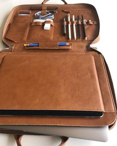 Mod Laptop here stacked with laptop tablet many pens battery cords cards & more #tigmod