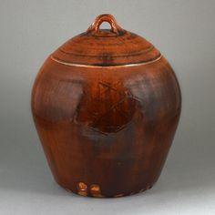 BERNARD LEACH  Ceramics (British: 1887-1979) -    Large lidded Jar, 1970s -  Stoneware, rich running brown glazes over an incised cross-hatch design