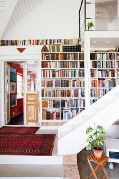 This loft space is complemented well by this huge wall of books. Library at your finger tips.