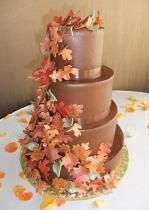 3 tier chocolate round wedding cake with colorful leaves.JPG
