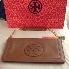 Host pick 3/6 Tory Burch Suki Reva Clutch Brand new, tag still on, authentic TB clutch in brown, leather, with gold hardware.  Measures 12 x 7 x 1. Tory Burch Bags Clutches & Wristlets