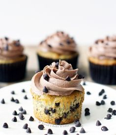 Banana Chocolate Chip Cupcakes with Chocolate Buttercream - mini chocolate chips engulfed in moist banana cupcakes and topped with Chocolate Buttercream.