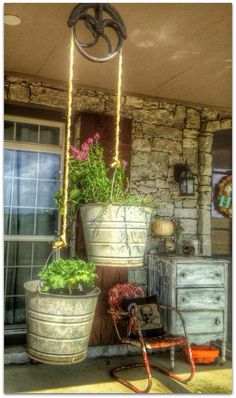 Repurpose old buckets and pulley to make unique hanging planters.