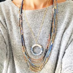 We love this necklace! Tiny gold nugget beads are strung on a cotton bamboo cord to create that lovely piece that is casual, yet unique! This neutral necklace triples as a long necklace, double it up