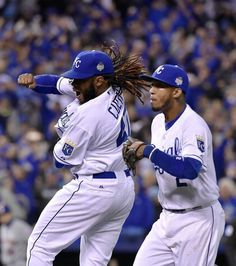 Kansas City Royals starting pitcher Johnny Cueto and shortstop Alcides Escobar celebarte after finishing the top of the eighth inning during game two of the World Series on Wednesday, October 28, 2015 at Kauffman Stadium in Kansas City, Mo.