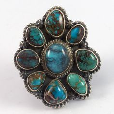 "Sterling Silver Ring set with a Cluster of Natural Bisbee Turquoise from Arizona. Ring Size: 9 1.625"" Width, 1.875"" Height .25"" Band Width"