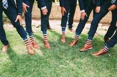 what if you did the fancy shoes and navy suit, and the fun part comes from the socks. I would do american flag socks, but everyone could wear their own corky patterned socks