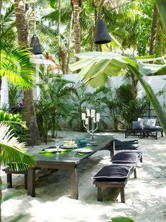 Beach Tropical Garden: A tropical outdoor dining space on the sand with hanging lanterns. Apparently it;s a garden in Goa, India. Designer unknown