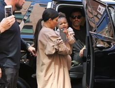Kim Kardashian Photos Photos - Kim Kardashian and North West are seen arriving at dad Kanye's NYC fashion show on September 16, 2015. - Kim Kardashian and Daughter North Arrive at the Kanye West Fashion Show in NYC