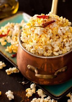 "Garlic Popcorn with Cayenne Pepper and Popcorn with ""Buffalo Wings"" Red Hot Sauce"