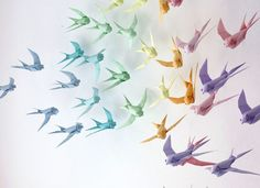 """This paper craft art installation is a Origami Swallows Set, called """"Pursuit of Happiness"""", created by Sipho Mabona. Do you want to fold your own Origami S Origami Arco Iris, Rainbow Origami, Origami And Kirigami, Origami Paper Art, Paper Crafting, Oragami, Rainbow Paper, Paper Quilling, Origami Swallow"""
