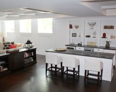 traditional basement, like the console table as a room divider