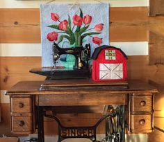 Red Barn sewing machine cover and Log Cabin by QuiltessaNatalie